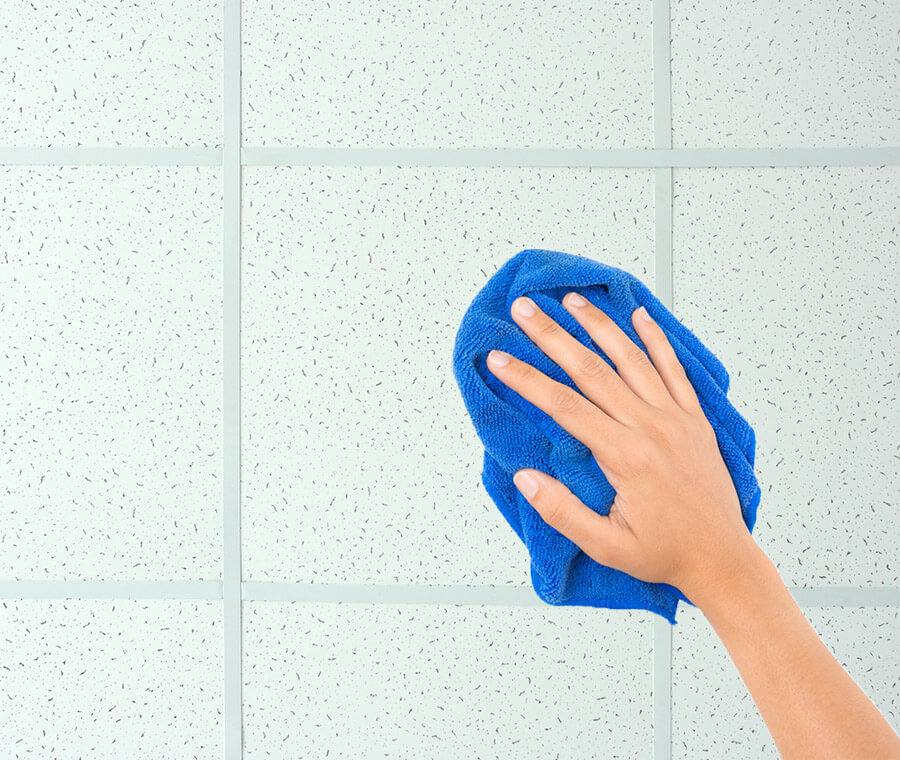 Wiping Down Ceiling Tile With Cloth